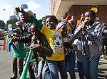 Young South African soccer fans from the Hillbrow district cheer for the Dutch soccer players who opened a Orange Cruyff  soccer Court  in Johannesburg June 10, 2010. Dutch soccer legend Johan Cruyff opened a soccer playground in the Hillbrow district.  REUTERS/Michael Kooren (SOUTH AFRICA) ...