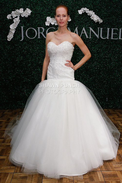 Model poses in a Zephyranthes bridal gown from the Jorge Manuel Haute Couture Fleur Collection 2014, during Couture Bridal Fashion Week, on October 12, 2013.