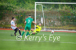 Bohemians Aaron Doran slips the ball under Kerry keeper Aaron O'Sullivan as team mate Alain Beaujanan looks on, in the U19 League of Ireland