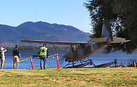 SIAI-Marchetti SM.1019, N16XC, taxiis down the ramp from the Natural High School lawn to Clear Lake during the Clear Lake Seaplane Splash-In, Lakeport, Lake County, California.  Mount Konocti is in the background.