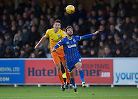 Luke O'Nien of Wycombe Wanderers wins the header from George Francomb of AFC Wimbledon during the Sky Bet League 2 match between AFC Wimbledon and Wycombe Wanderers at the Cherry Red Records Stadium, Kingston, England on 21 November 2015. Photo by Alan  Stanford/PRiME.