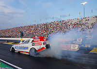 Aug 29, 2014; Clermont, IN, USA; NHRA funny car driver Bob Tasca III during qualifying for the US Nationals at Lucas Oil Raceway. Mandatory Credit: Mark J. Rebilas-USA TODAY Sports