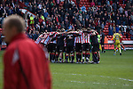 Sheffield United 2 Leeds United 0, 19/03/2011. Bramall Lane, Championship. Sheffield United players in a huddle celebrating their victory at the end of the Npower Championship fixture with Leeds United. The home team won the game by two goals to nil watched by a crowd of 23,728. Bramall Lane is the world's oldest professional football ground and at one time hosted both football and cricket. Photo by Colin McPherson.