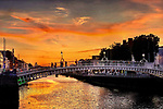 Sunset on the The Ha'penny Bridge. Known later for a time as the Penny Ha'penny Bridge, and officially the Liffey Bridge, is a pedestrian bridge built in May 1816 over the River Liffey in Dublin, Ireland