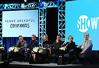 """PASADENA, CA - JANUARY 13: Creator/Executive Producer John Logan and cast members Nathan Lane, Natalie Dormer, Daniel Zovatto, Adriana Barraza, and Rory Kinear attend the panel for """"Penny Dreadful: City of Angels"""" during the Showtime presentation at the 2020 TCA Winter Press Tour at the Langham Huntington on January 13, 2020 in Pasadena, California. (Photo by Frank Micelotta/PictureGroup)"""