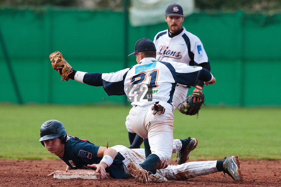 16 October 2010: Luc Piquet of Rouen slides safely into second base as Yann Dal Zotto fails to tag him out during Rouen 16-4 win over Savigny, during game 1 of the French championship finals, in Savigny sur Orge, France.
