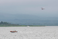 BNPS.co.uk (01202 558833)<br /> Pic: MaxWillcock/BNPS<br /> <br /> Pictured: A police boat and the HM Coastguard helicopter from Lee-on-the-Solent searching the water.<br /> <br /> There are fresh calls for a holiday park to increase safety measures at a notorious beach where one swimmer has drowned and almost 20 children rescued this summer. <br /> <br /> In the latest incident a dad and his two young sons were plucked to safety in the nick of time after they were swept away by a rip tide at Rockley Park in Poole Harbour, Dorset.<br /> <br /> It happened a month after hero swimmer Callum Baker-Osborne, 18, drowned while helping to rescue 13 children at the same spot.<br /> <br /> And before that two young girls were saved from drowning by a paddleboarder.
