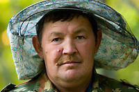 Portrait of Alkar Isanomatov, ranger-beekeeper. This particular post had been created by the reserve's director Mikhail Nikolaevich Kosarev. Today there are 15 forest wardens-beekeepers, all descendants of the wild bee wardens.