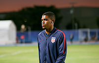 GEORGETOWN, GRAND CAYMAN, CAYMAN ISLANDS - NOVEMBER 19: Reggie Cannon #20 of the United States walks to the field during a game between Cuba and USMNT at Truman Bodden Sports Complex on November 19, 2019 in Georgetown, Grand Cayman.