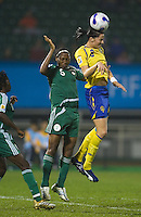 Nigeria defender (5) Onome Ebi goes up for a header against Sweden midfielder (8) Charlotta Schelin. Sweden (SWE) tied Nigeria (NGA) 1-1 during a FIFA Women's World Cup China 2007 opening round Group B match at Chengdu Sports Center Stadium, Chengdu, China, on September 11, 2007.