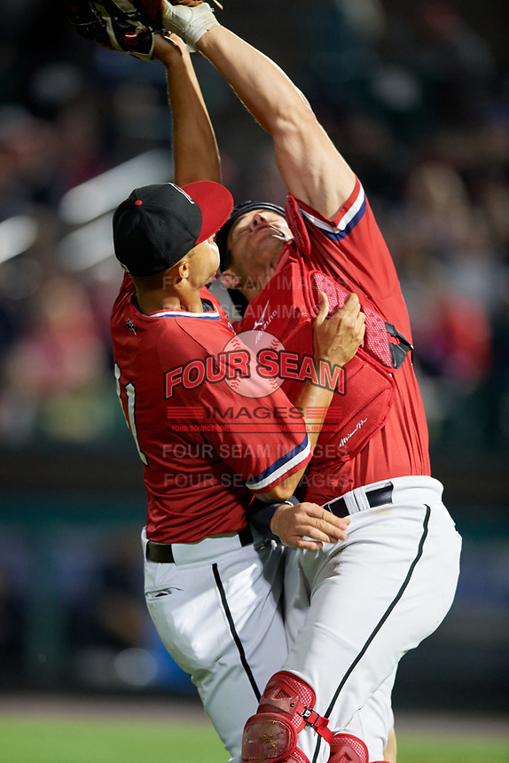 Rochester Red Wings catcher Anthony Recker (30) collides with third baseman Leonardo Reginatto (11) while catching a foul ball popup during the first game of a doubleheader against the Scranton/Wilkes-Barre RailRiders on August 23, 2017 at Frontier Field in Rochester, New York.  Rochester defeated Scranton 5-4 in a game that was originally started on August 22nd but postponed due to inclement weather.  (Mike Janes/Four Seam Images)