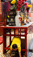 Worshiper Crawling under Table in front of Altar to Gain Merit and Blessing, Sin Sze Si Ya Taoist Temple, Chinatown, Kuala Lumpur, Malaysia.  Oldest Taoist temple in Kuala Lumpur (1864).
