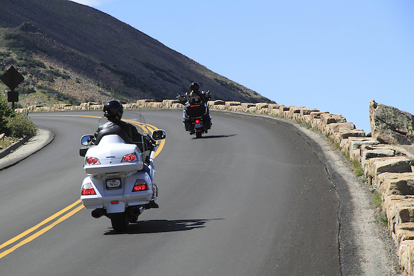 Two motorcyclists on Trail Ridge Road in Rocky Mountain National Park, west of Estes Park, Colorado.