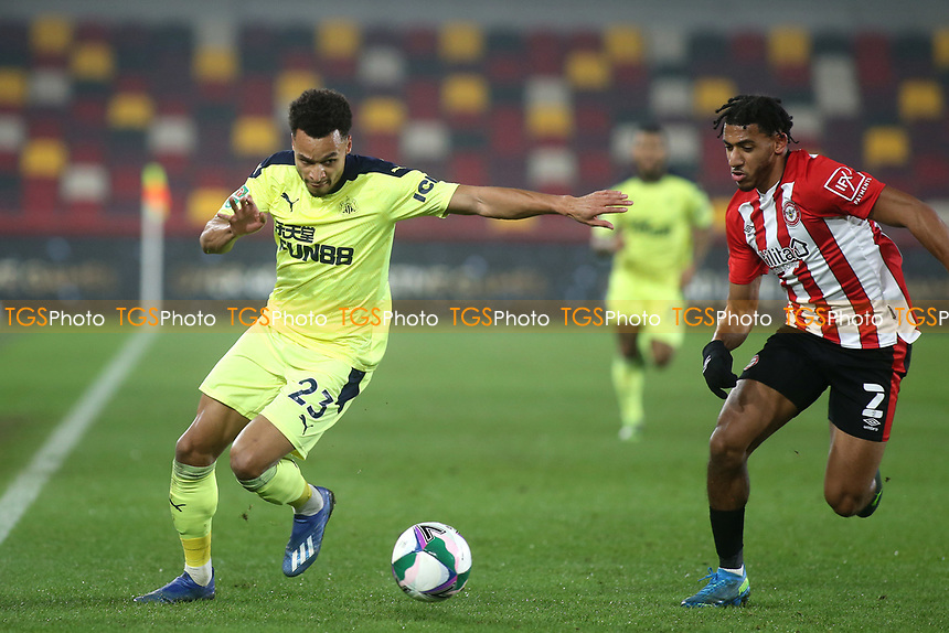 Jacob Murphy of Newcastle United in possession as Brentford's Dominic Thompson looks on during Brentford vs Newcastle United, Carabao Cup Football at the Brentford Community Stadium on 22nd December 2020