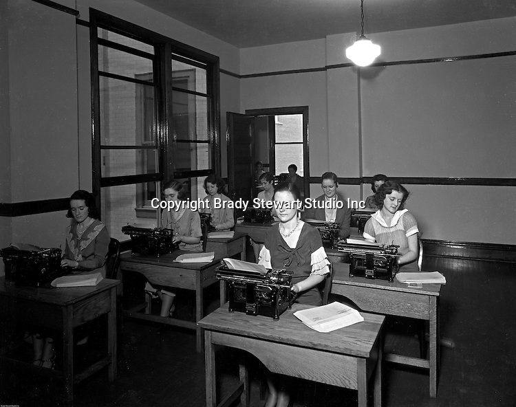 Pittsburgh PA: Young women working hard in Duquesne University's typing class.<br /> Brady Stewart was hired to photography the campus, classrooms, and offices for a publication to increase enrollment at the Catholic University.