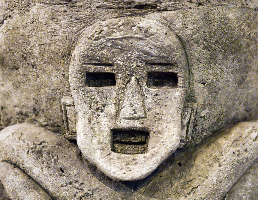 Ancient Asian stone carving of a man.