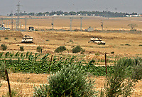 """Isreal Tanks apear during Hamas demonstration in the Karni crossing east of Gaza City that injured 10 people and killing people by the Israeli army on May 22, 2008""""photo by Fady Adwan"""""""