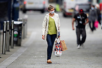 Pictured: A lady walks down Oxford Street, Swansea city centre, Wales, UK. Monday 28 September 2020<br /> Re: Local lockdown will be in force from 6pm on the 27th September 2020 due to the Covid-19 Coronavirus pandemic, in Swansea, Wales, UK.