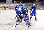 Buffalo Junior Sabres forward Nolan Sheeran (81) looks for the puck in front of Jake Evans (17) during a game against the St. Michaels Buzzers at the Frozen Frontier outdoor game at Frontier Field on December 15, 2013 in Rochester, New York.  St. Michael's defeated Buffalo 5-4.  (Copyright Mike Janes Photography)