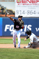 Erie SeaWolves second baseman Marcus Lemon (39) throws to first as Tony Wolters (1) slides in during a game against the Akron RubberDucks on May 18, 2014 at Jerry Uht Park in Erie, Pennsylvania.  Akron defeated Erie 2-1.  (Mike Janes/Four Seam Images)