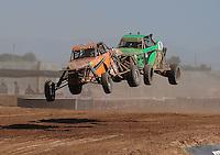 Apr 17, 2011; Surprise, AZ USA; LOORRS driver Bobby Pecoy (11) leads Justin Davis (85) during round 4 at Speedworld Off Road Park. Mandatory Credit: Mark J. Rebilas-