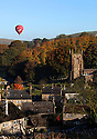 09/10/12...A hot air balloon glides over The Peak District as the early morning sun bathes Hartington, Derbyshire in a riot of Autumn colour....All Rights Reserved - F Stop Press.  www.fstoppress.com. Tel: +44 (0)1335 300098.Copyrighted Image. Fees charged will reflect previously agreed terms or space rates for individual publications, states or country.