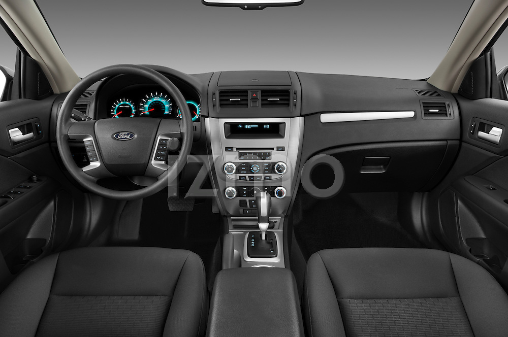 Straight dashboard view of a 2010 Ford Fusion SE.