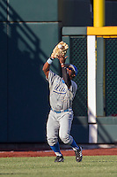 UCLA pitcher Nick Vander Tuig (21) makes a catch against the North Carolina State Wolfpack during Game 8 of the 2013 Men's College World Series on June 18, 2013 at TD Ameritrade Park in Omaha, Nebraska. The Bruins defeated the Wolfpack 2-1, eliminating North Carolina State from the tournament. (Andrew Woolley/Four Seam Images)