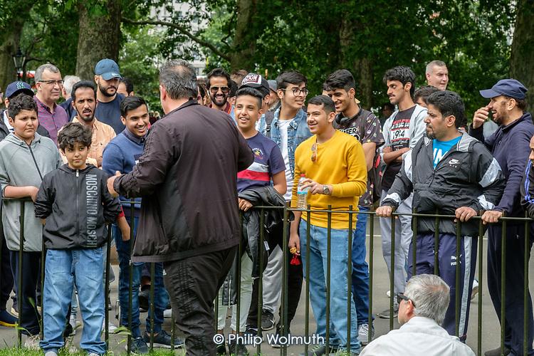 Debaters speaking in Arabic, Speakers' Corner, Hyde Park, London.