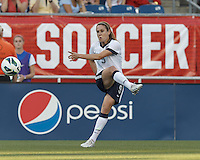 USWNT midfielder Heather O'Reilly (9) passes the ball.  In an international friendly, the U.S. Women's National Team (USWNT) (white/blue) defeated Korea Republic (South Korea) (red/blue), 4-1, at Gillette Stadium on June 15, 2013.