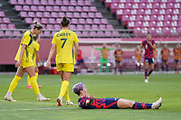KASHIMA, JAPAN - AUGUST 5: Megan Rapinoe #15 of the United States looks for a call during a game between Australia and USWNT at Kashima Soccer Stadium on August 5, 2021 in Kashima, Japan.