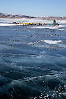 Sunday March 11, 2007   ----    Jeff King runs on the slough ice  nearing Unalakleet on Sunday afternoon.