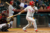 Philadelphia Phillies third baseman Michael Martinez #7 swings during the Major League baseball game against the Houston Astros on September 16th, 2012 at Minute Maid Park in Houston, Texas. The Astros defeated the Phillies 7-6. (Andrew Woolley/Four Seam Images).