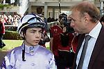 .Gentoo wins the race. Jockey Gerald Mosse Owner : S TRipier Mondancin. Trainer : Lyon (S). .Jockey Maxime Guyon  with Los Cristianos 's trainer , A. Couetil