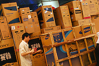 Electronic goods belonging to Toshiba, Samsung and Sony are piled up in an electronics market in Guangzhou, China.  ..