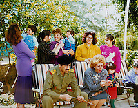 Baghdad, Iraq, Saddam's family pictures, date unknown..Saddam, center, with his wife Sajida, daughters and grand-children during a barbecue party
