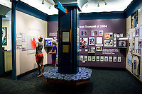 Visitors talk over one of the many exhibits at the Pacific Tsunami Museum in downtown Hilo, Big Island of Hawai'i.