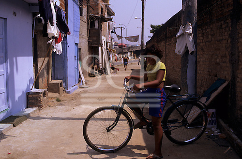Sao Paulo, Brazil. Favela Vila Prudente; child on a bicycle.