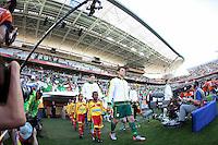 Robert Koren captain of Slovenia leads out his team at the Peter Mokaba stadium for the game against Algeria