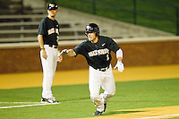Steven Brooks #1 of the Wake Forest Demon Deacons takes off for home on a passed ball during the game against the Miami Hurricanes at Gene Hooks Field on March 18, 2011 in Winston-Salem, North Carolina.  Photo by Brian Westerholt / Four Seam Images
