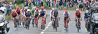 From right to left: Shelley Olds (USA, 7th), Marianne Vos (Netherlands, Gold medal), Trixi Worrack (Germany, 33rd), Emma Johansson (Sweden, 6th), Olga Zabelinskaya (Russia, Bronze medal), then four more to the left in plain white hat, Elizabeth Armitstead (Great Britain, Silver medal).  Olympics 2012.  Women's cycle road race passes along the Shere bypass, the A25, on it's way to Box Hill and then back to the finish in London.
