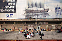 Pictured: Migrants at the port Friday 26 February 2016<br />Re: Hundreds of refugees that crossed the border from Turkey to the Greek islands, have arrived at the port of Piraeus near Athens, Greece