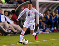 Ali Krieger #11 of the United States dribbles