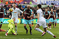 (L-R) Adrian of West Ham looks on as Mike van der Hoorn of Swansea City, Pablo Zabaleta of West Ham and Federico Fernandez of Swansea City fight for the ball during the Premier League match between Swansea City and West Ham United at The Liberty Stadium, Swansea, Wales, UK. Saturday 03 March 2018