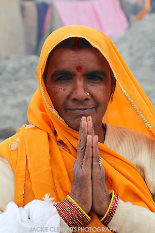 One of the millions of pilgrims at the Maha Kumbh Mela 2013 joins her hands to say Namaste