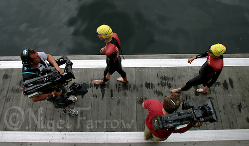 05 SEP 2004 - LIVERPOOL, GBR - Liz Blatchford and Tanya De Boer are filmed by a television cameraman as they walk along the pontoon before the start of the womens race at the Great Liverpool Triathlon (PHOTO (C) NIGEL FARROW)