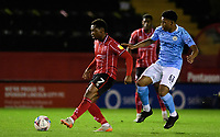 Lincoln City's Tayo Edun under pressure from  Manchester City U21's Keyendrah Simmonds<br /> <br /> Photographer Chris Vaughan/CameraSport<br /> <br /> EFL Papa John's Trophy - Northern Section - Group E - Lincoln City v Manchester City U21 - Tuesday 17th November 2020 - LNER Stadium - Lincoln<br />  <br /> World Copyright © 2020 CameraSport. All rights reserved. 43 Linden Ave. Countesthorpe. Leicester. England. LE8 5PG - Tel: +44 (0) 116 277 4147 - admin@camerasport.com - www.camerasport.com