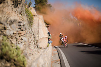 Fausto Masnada (ITA/Androni Giocattoli - Sidermec) is the first up the Capo Berta<br /> <br /> thik smoke once again covers the Capo Berta passage of the riders > but this time year the bushes catch fire (!! 🔥) and flair up just as the riders ride by<br /> <br /> 110th Milano-Sanremo 2019 (ITA)<br /> One day race from Milano to Sanremo (291km)<br /> <br /> ©kramon
