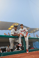 Tri-City ValleyCats Manny Ramirez (30) and Deury Carrasco (23) while in a fog delay during a NY-Penn League game against the Brooklyn Cyclones on August 17, 2019 at MCU Park in Brooklyn, New York.  Brooklyn defeated Tri-City 2-1.  (Mike Janes/Four Seam Images)