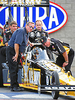 Oct. 31, 2008; Las Vegas, NV, USA: NHRA top fuel dragster driver Tony Schumacher sits in his car as crew chief Alan Johnson (right) speaks with him as car owner Don Schumacher stands alongside during qualifying for the Las Vegas Nationals at The Strip in Las Vegas. Mandatory Credit: Mark J. Rebilas-